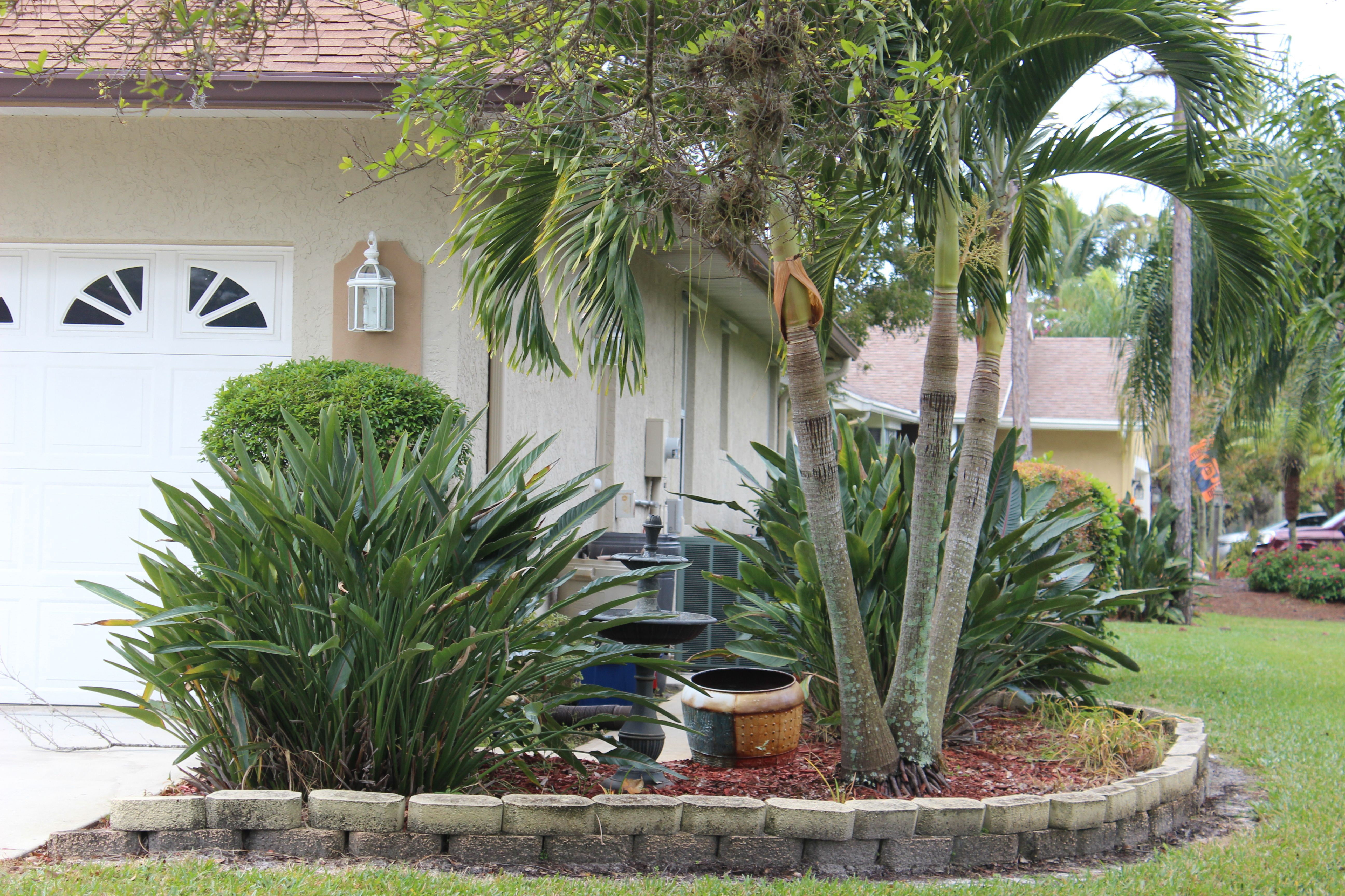 Concealing Air Conditioners With Artificial Outdoor Plants