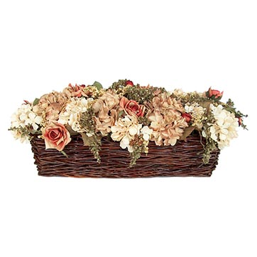 Dried hydrangeas and roses in medium oblong willow basket by purple