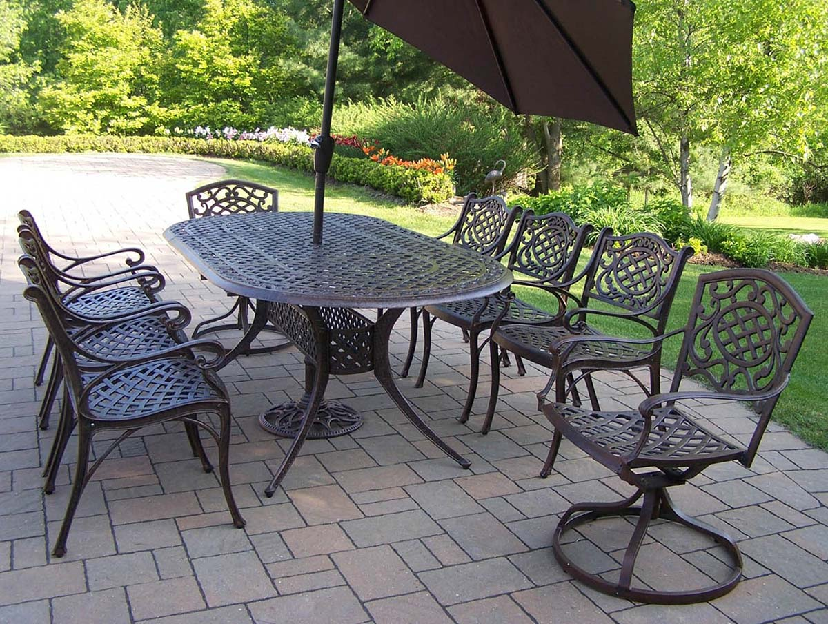 Beautiful Oval Dining Set Swivel Chairs Umbrella Product Photo